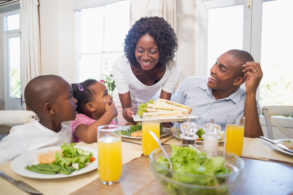 Happy family enjoying a healthy meal together at home in the kitchen-1